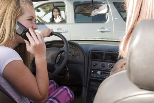 teenage girl using her phone while driving and is going to be in a accident..preview